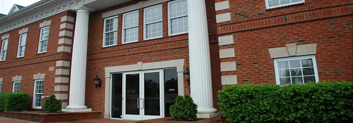 Chiropractic-Raleigh-NC-Building-Exterior-ESSENTIAL-HERO-714x250-1.jpg